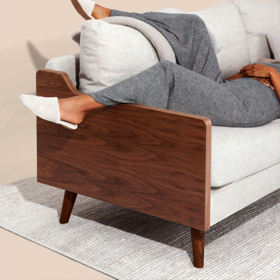 A person lying on a couch  Description automatically generated with low confidence